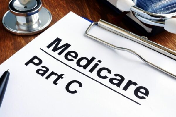 Stethoscope and a medical record with Medicare Part C letterings