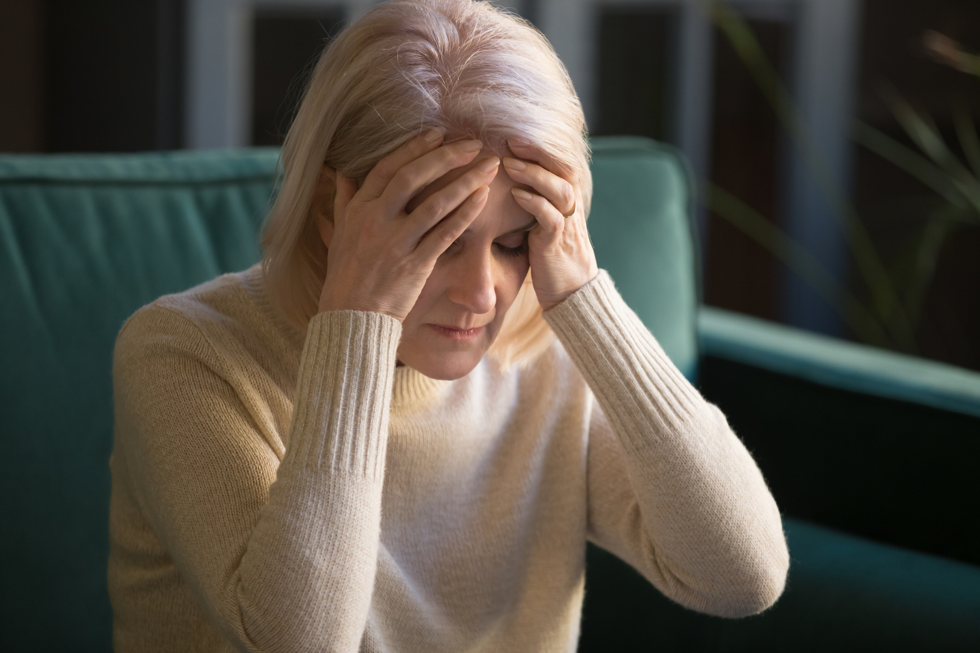 Stressed elderly woman coping with mental health