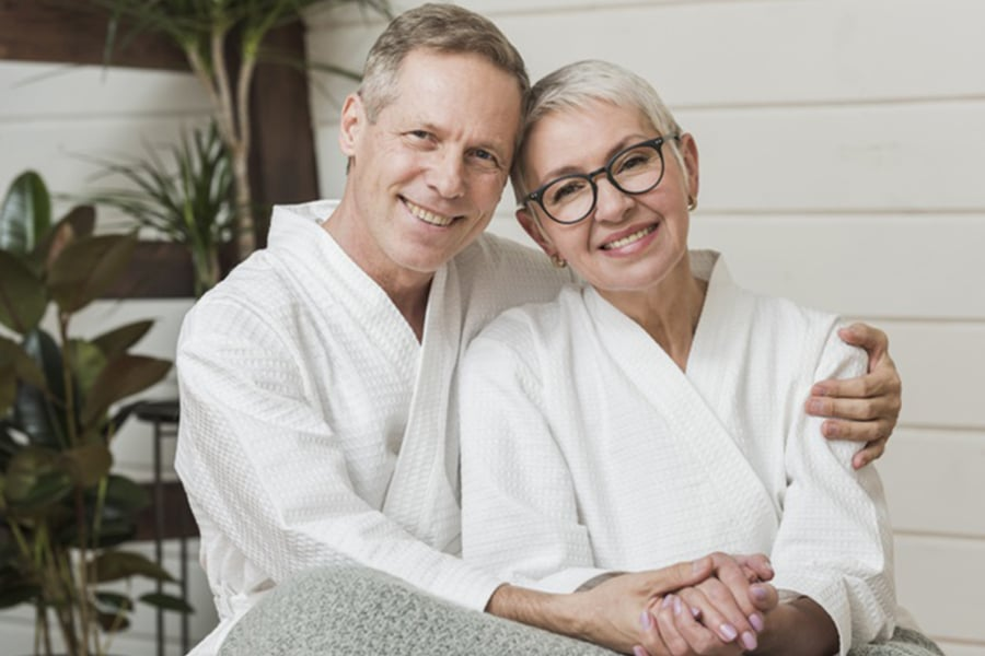 Senior couple holding hands - Medigap Enrollment