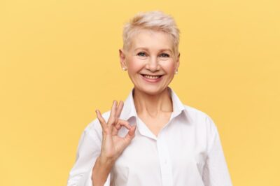 Senior with ok-gesture rejoicing about great medical plans